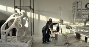 D-Shape D-Shape, una macchina che deposita un legante liquido per strati successivi di materiale granulare